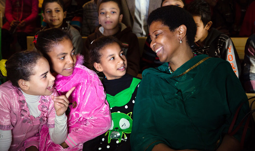 UN Women Executive Director Phumzile Mlambo-Ngcuka laughs with a group of young girls during a visit to one of UN Women's Cairo Safe City programme sites on 3 February 2015. (Photo: UN Women Egypt/Mohamed Ezz Aldin.)