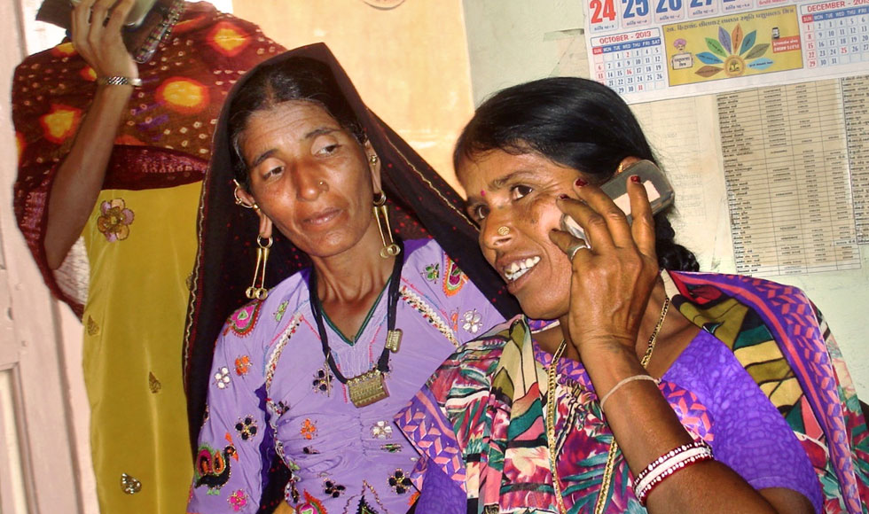 The Fund for Gender Equality's high-impact programmes include one linking rural, marginalized women to mobile technology. They use it to connect with local government representatives and obtain better services—the process has so far backed the processing of 7,000 claims for public benefits, among other achievements. (Photo: Jayshree Joshi for Kutch Mahila Vikas Sangathan [KMVS].)