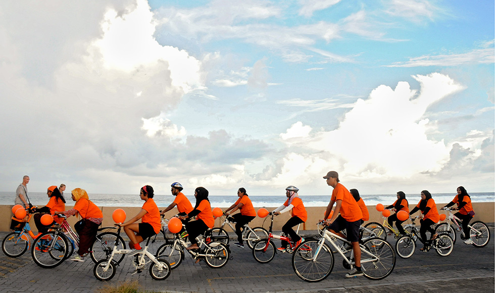 Cyclists in the Maldives.
