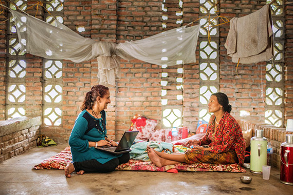 Sujata Sharma Poudel, a psychosocial counsellor, speaks with a local woman at one of the 5 UN Women-supported multi-purpose centres (Panchkhal, Nepal, July 2015). Photo: UN Women/N. Shrestha