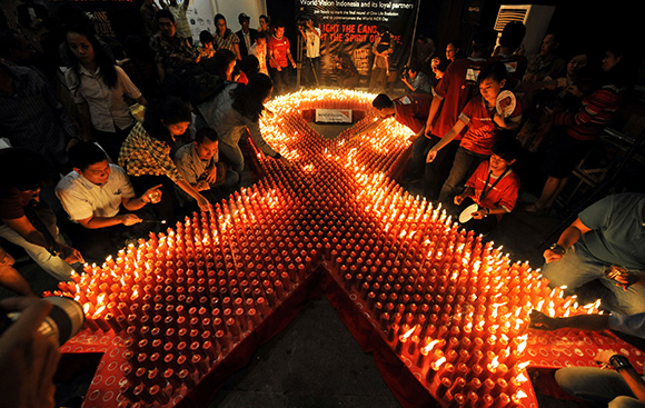 Indonesian volunteers light candles during World AIDS Day in Jakarta. Photo: Adek Berry/AFP/Getty Images