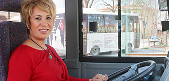 Pelin Aslantaş, 43, is the only female bus driver in the city of Edirne, Turkey. Photo: UN Women Gizem Yarbil