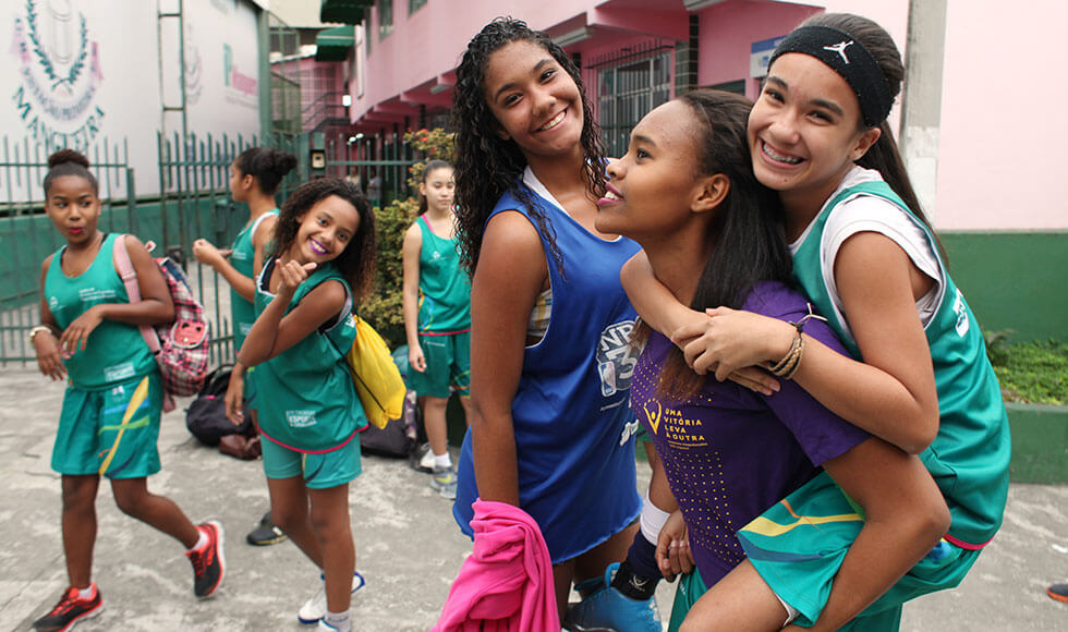 """Girls on a basketball team in Mangueira, Brazil learn life skills to combat gender inequalities through """"One Win Leads to Another,"""" an Olympic legacy programme developed as part of a UN Women partnership with the International Olympic Committee. Photo: UN Women/Gustavo Stephan."""