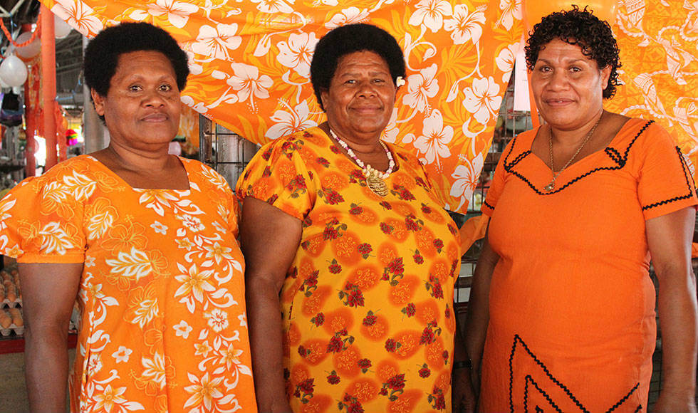 Scaled-up action to end violence against women in Fiji, including the first national protocol to respond to cases, has emerged from the response to a natural disaster. Women market vendors show their support by decorating their stalls in orange, symbolizing a brighter future without violence, and wearing the colour too. Photo: UN Women/Ellie van Baaren.