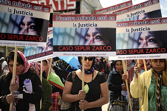 Women call for justice in the Sepur Zarco case. The first of its type in Guatemala, it sent two former military leaders to jail for rape and sexual slavery, and stipulated monetary compensation for survivors. Photo: Ohan Ordonez/AFP/Getty Images.