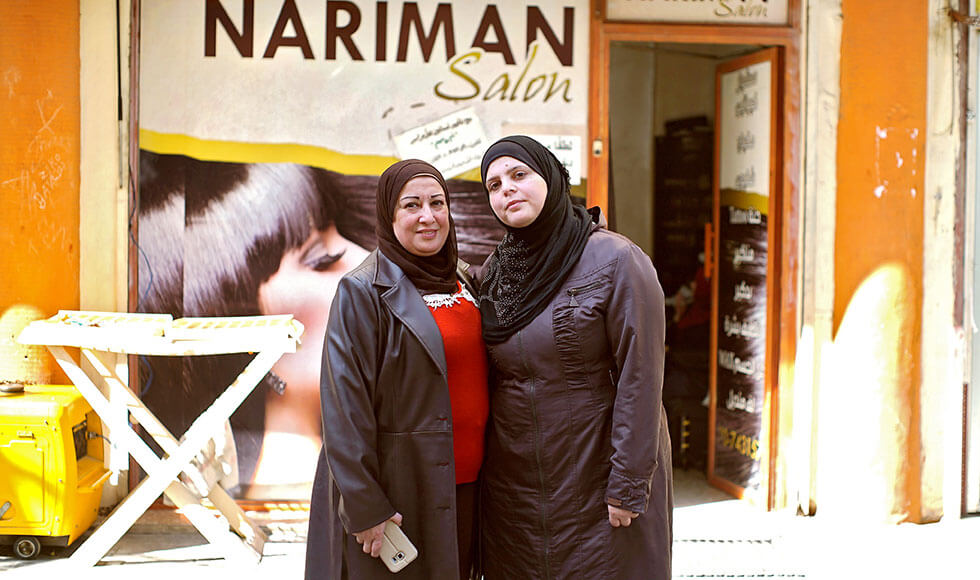 Zainab (at right) fled with her family from Syria to Beirut. Initially in desperate straits, she found a way forward through a UN Women-assisted training programme that equipped her with skills to work in a beauty salon. Photo: UN Women/Nathan Beriro.