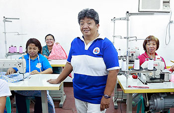 Edna Valdez, 58, was elected as the President of Bannuar Ti La Union, an organization that works for migrant women's rights in the La Union province of Philippines, shortly after she joined as a member in 2000. Photo: UN Women/Norman Gorecho.