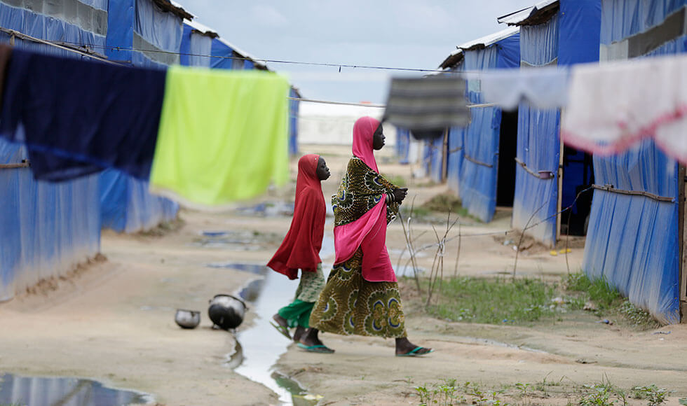 Violent extremism by Boko Haram has driven this woman and child into a refugee camp in Nigeria. Camp centres designed for women provide the specific services they need. Photo: AP Photo/Sunday Alamba.