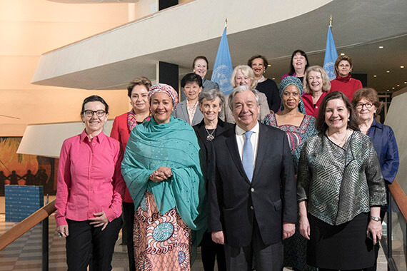 United Nations Secretary-General António Guterres joins women members of the Senior Management Group to celebrate gender parity among top managers at UN headquarters in New York. Group members include Deputy Secretary-General Amina Mohammed (first row, second from left) and UN Women Executive Director Phumzile Mlambo-Ngcuka (second row, second-from-right). Photo: UN Photo/Mark Garten.