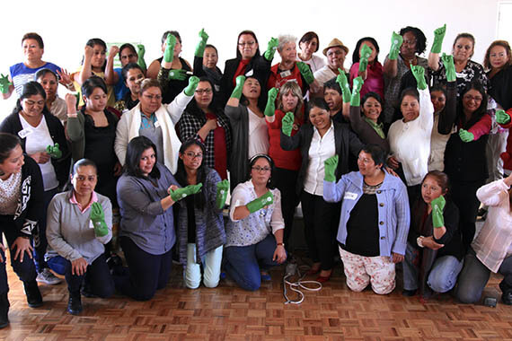 At a meeting in Mexico City, members of the Mexican National Union of Domestic Workers put the gloves on to gear up for claiming their rights. They have driven a new national agenda to fully protect the rights of 2.4 million domestic workers, including through a collective labour contract. Photo: Carolina Corral, courtesy of Instituto de Liderazgo Simone de Beauvoir.