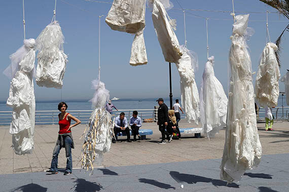 Sometimes a dress speaks louder than words. Women's activists in Beirut, Lebanon strung up white wedding dresses in a striking protest against a longstanding law allowing a rapist to go free if he marries his victim. The movement quickly gained momentum, resulting in abolishment of the law. Photo: AP Photo/Hussein Malla.