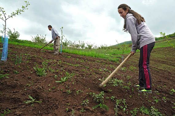 In Serbia, many of Milica Stojanovic's friends have moved from their small village to nearby towns. She decided to stay and enjoy growing vegetables, a choice back by a gender-responsive local public budget. It invests equally in services required by women and men, including those linked to agriculture. Photo: UN Women.