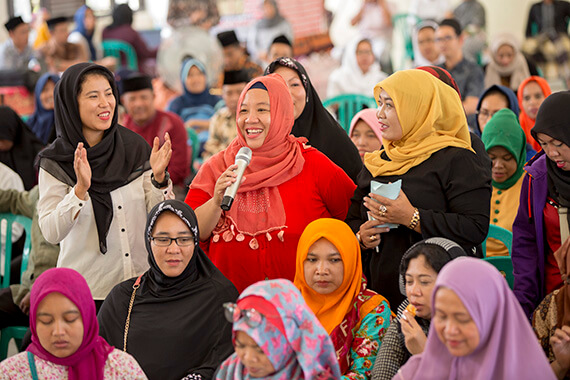 Women gathered at one of the oldest Islamic boarding schools in Indonesia to share experiences in fostering peace in their communities. Photo: UN Women/Ryan Brown.