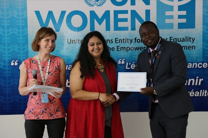 Cecil from Sierra Leone receives his certificate alongside Carlotta and Osika. Photo: UN Women/ Keneddy Okoth