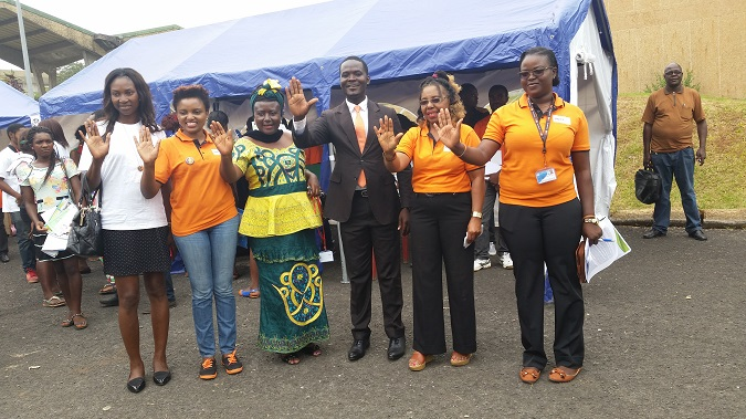 """Vice Chancellor (second from left in orange), Regional Delegate of Women's empowerment and the family (fourth from left) and UN staff say """"NO"""" to violence against women in Cameroon. Photo credit: UN Women"""