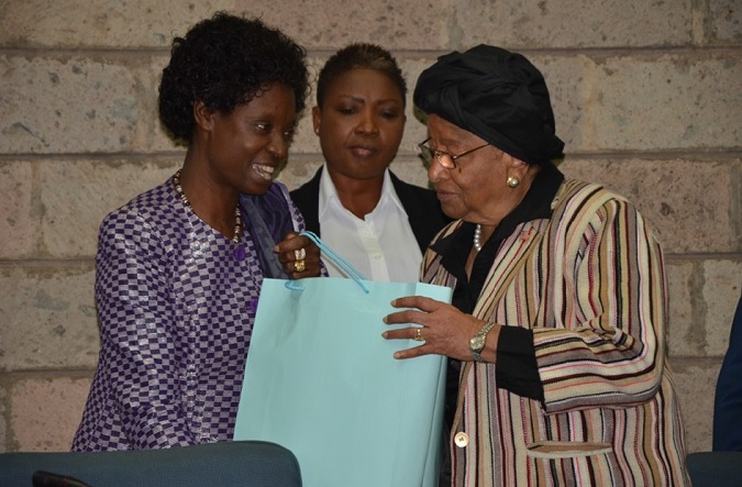 Ms. Josephine Odera, UN Women's Advisor on Leadership and Governance-Eastern and Southern Africa Region presents a gift to President Johnson-Sirleaf . Photo credit: UN Women/ Martha Wanjala