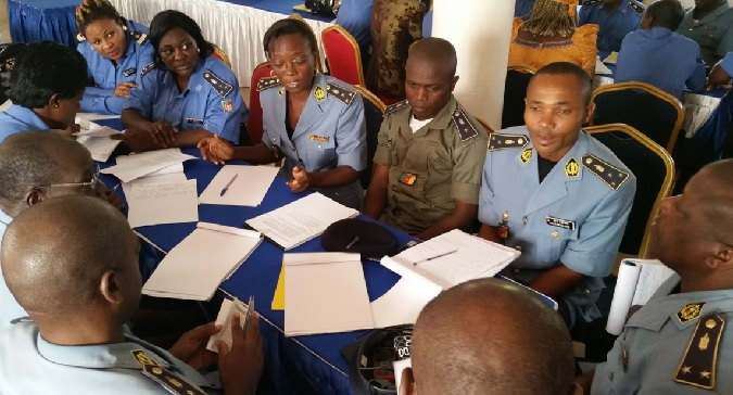 Cross section of Police Officers brainstorming on how to better protect women and children in group work. Photo credits: J FAJONG/UN Women
