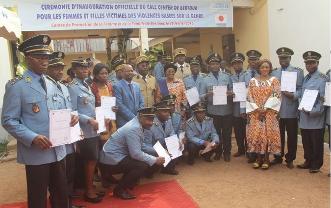 Minister, Ambassador of Japan and UN Women Representative flanked by Police officers during award of attestation after training on protecting women and children during humanitarian crises. Photo credit: J Fajong/UN Women