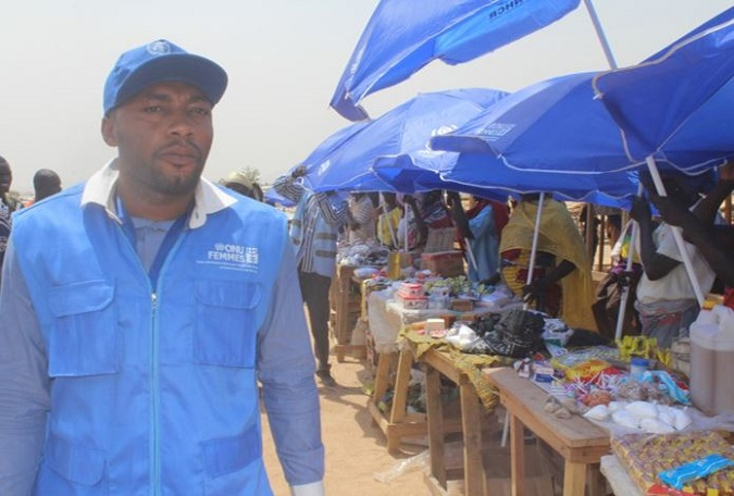 Jimmy Henry N. assisting female refugees on rapid income generating activities at the Minawao refugee camp