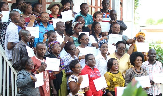 Cross section of participants pose for family photo at the end of training