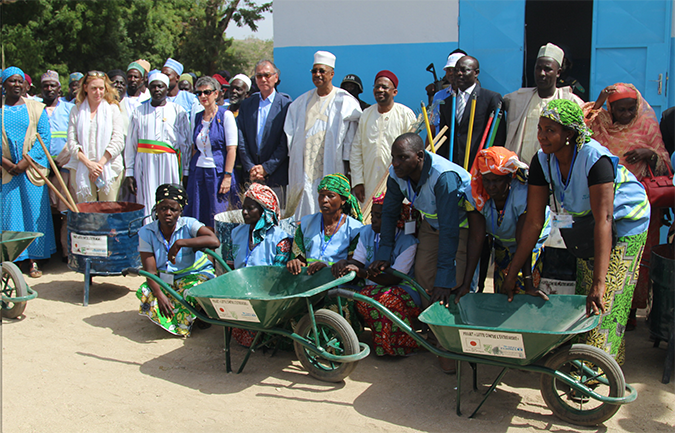 Management committee of Zamay Market receive cleaning materialts.