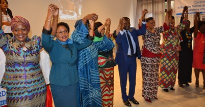 To symbolize the unity of the Network, all women leaders and guests held hands. Photo - UN Women DRC