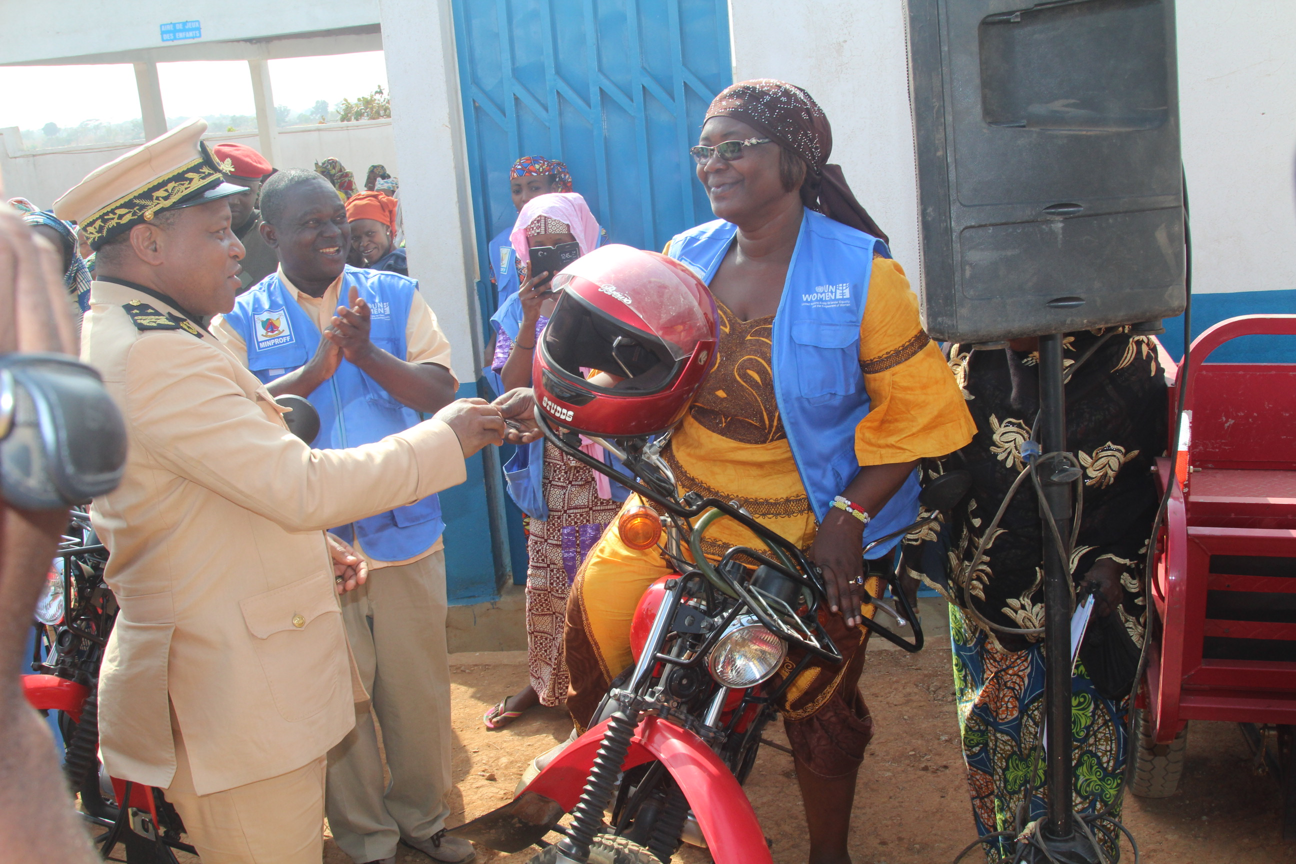 Worker at WCS receives keys of Motocycle from Divisional Officer with joy. Photo credit: Fajong Joseph-UN Women