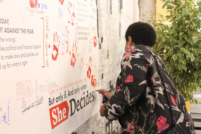 Ms Phumzile Mlambo-Ncguka, UN Women Executive Director signs She Decides pledge Wall