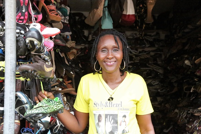 Catherine is one of thousands of beneficiaries of the 'Next Level' Business Development Skills Training Programme. Her story of success is helping inspire her fellow market-women in Ma Juah Market in Monrovia. Photo: UN Women/Winston Daryoue