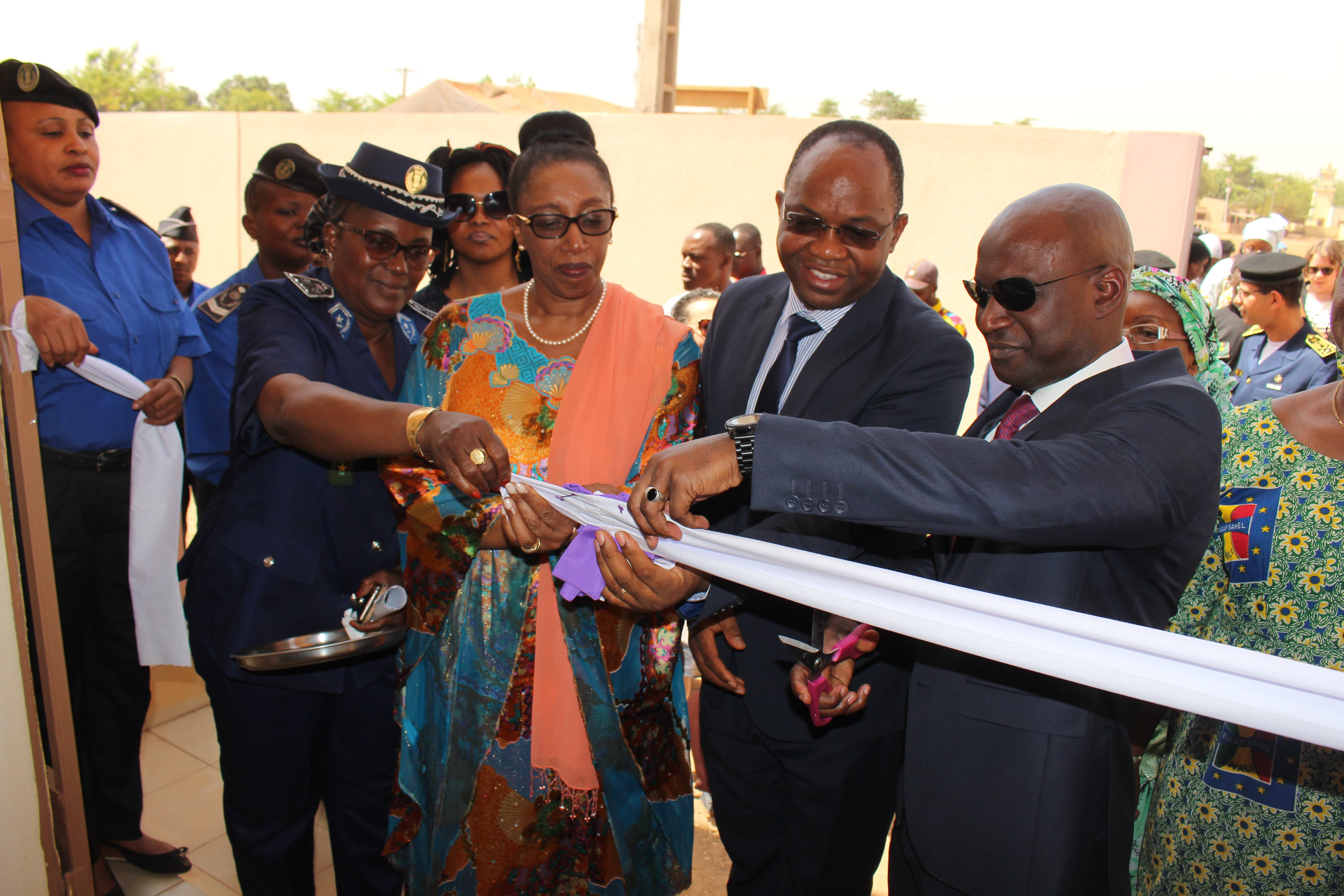 Cutting of the ribbon -from Right to Left- The Minister of Security and Civil Protection_ The Resident Representative of UNWOMEN Mali_ The Resident Coordinator of the SNU in Mali_ The Director of the Center