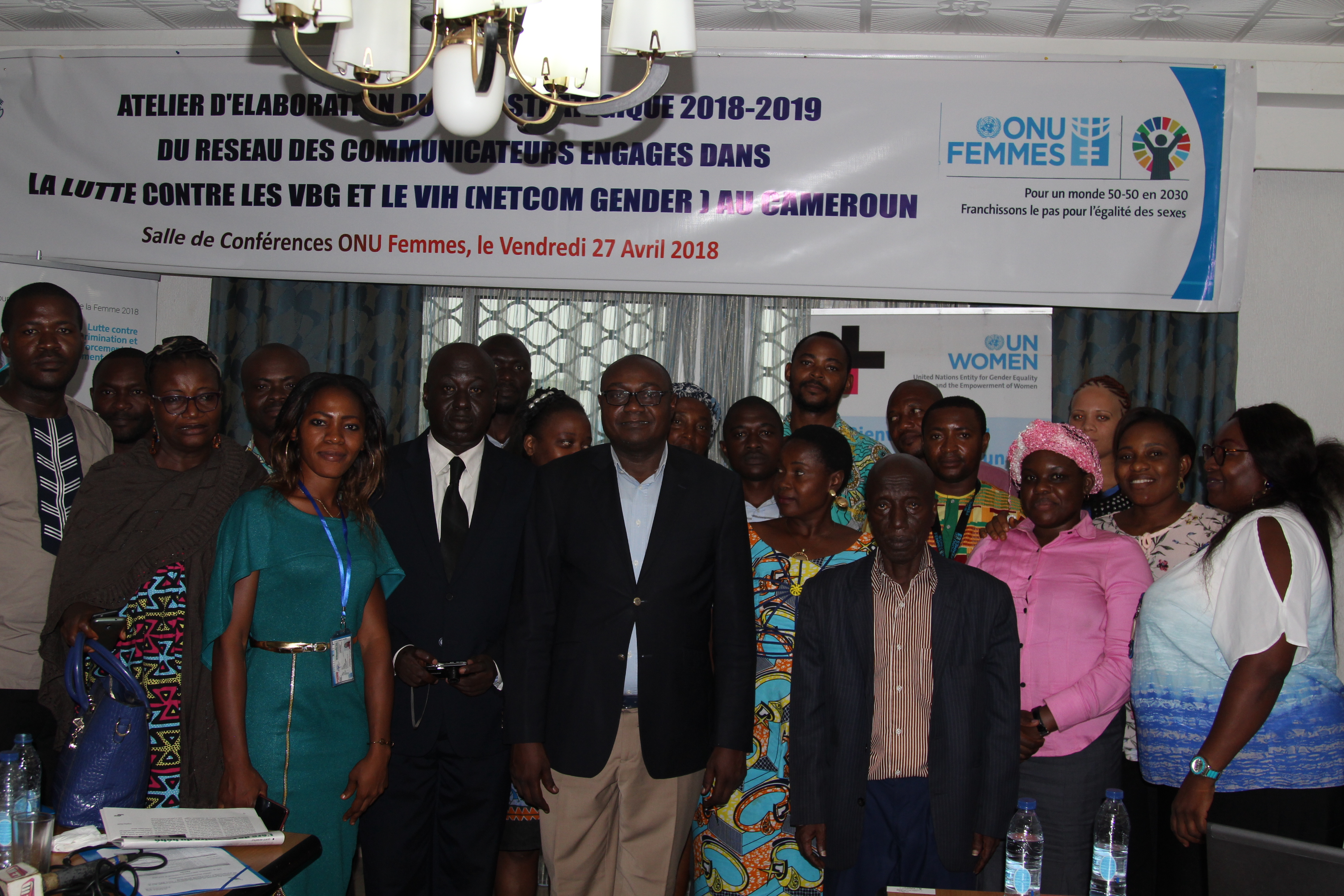 Members of the journalist platform NETCOM GENDER posing for a family photo with the National Programme Officer, Joseph Ngoro (centre) during the workshop. Photo credit; Teclaire Same, UN Women.