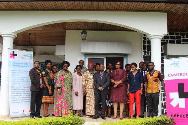 Participants pose for family photo during the sensitization workshop on integrating menstrual hygine management needs of women in ongoing policy reforms organized by UN Women. Photo credit; Teclaire Same, UN Women.