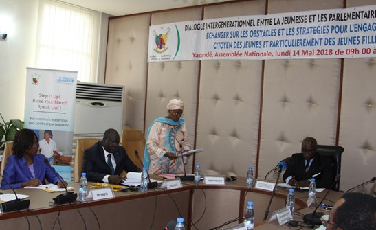 Minister Marie-Therese Abena, Minister of Women Empowerment and the Family delivering her speech during the event flanged by Minister of Youth Affairs and Civic Education, Mounouna Foutsou (left) and Hon Etong, 1st Vice President of the National Assembly. Pjoto credit, Teclaire Same, UN Women Cameroon.