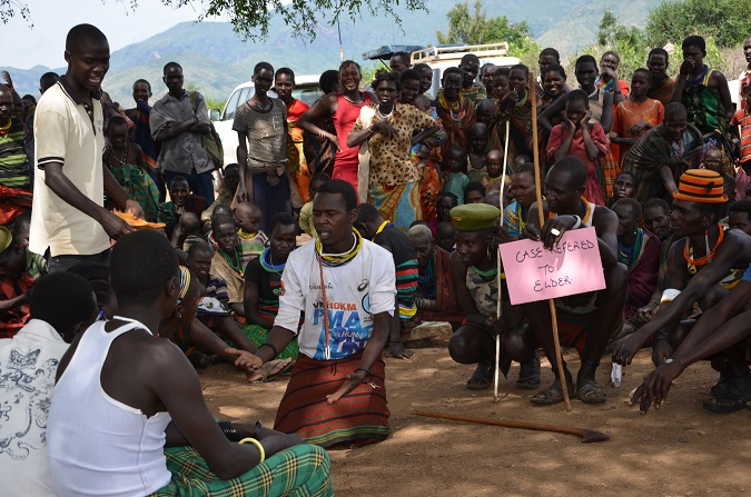 Youth conduct a role play session on the conduct of the elders during the community session. Photo: UN Women/ Aidah Nanyonjo