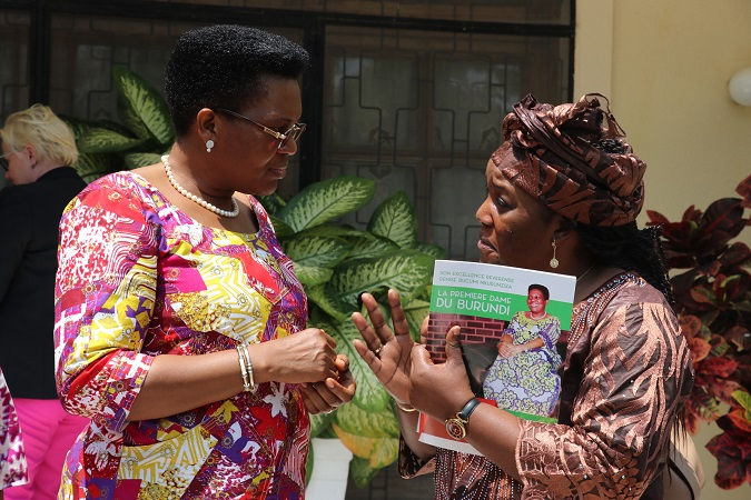 Arlette Mvondo from UN Women Burundi Country Office shares a moment with First Lady Denise Nkurunziza during the visit to her office in Bujumbura. Photo: UN Women/ Faith Bwibo