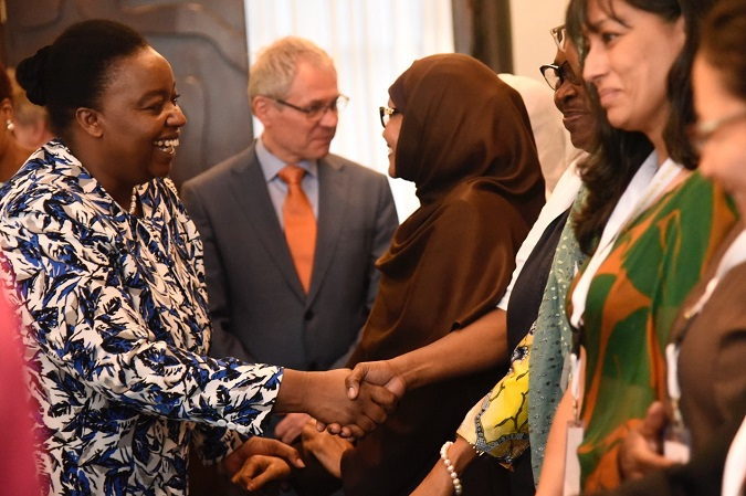 (Left) Amb. Monica Juma, Cabinet Secretary of the Ministry of Foreign Affairs in Kenya interacts with participants during the opening of the high-level peer review on women peace and security in Kenya. Photo: UN Women/ Kennedy Okoth
