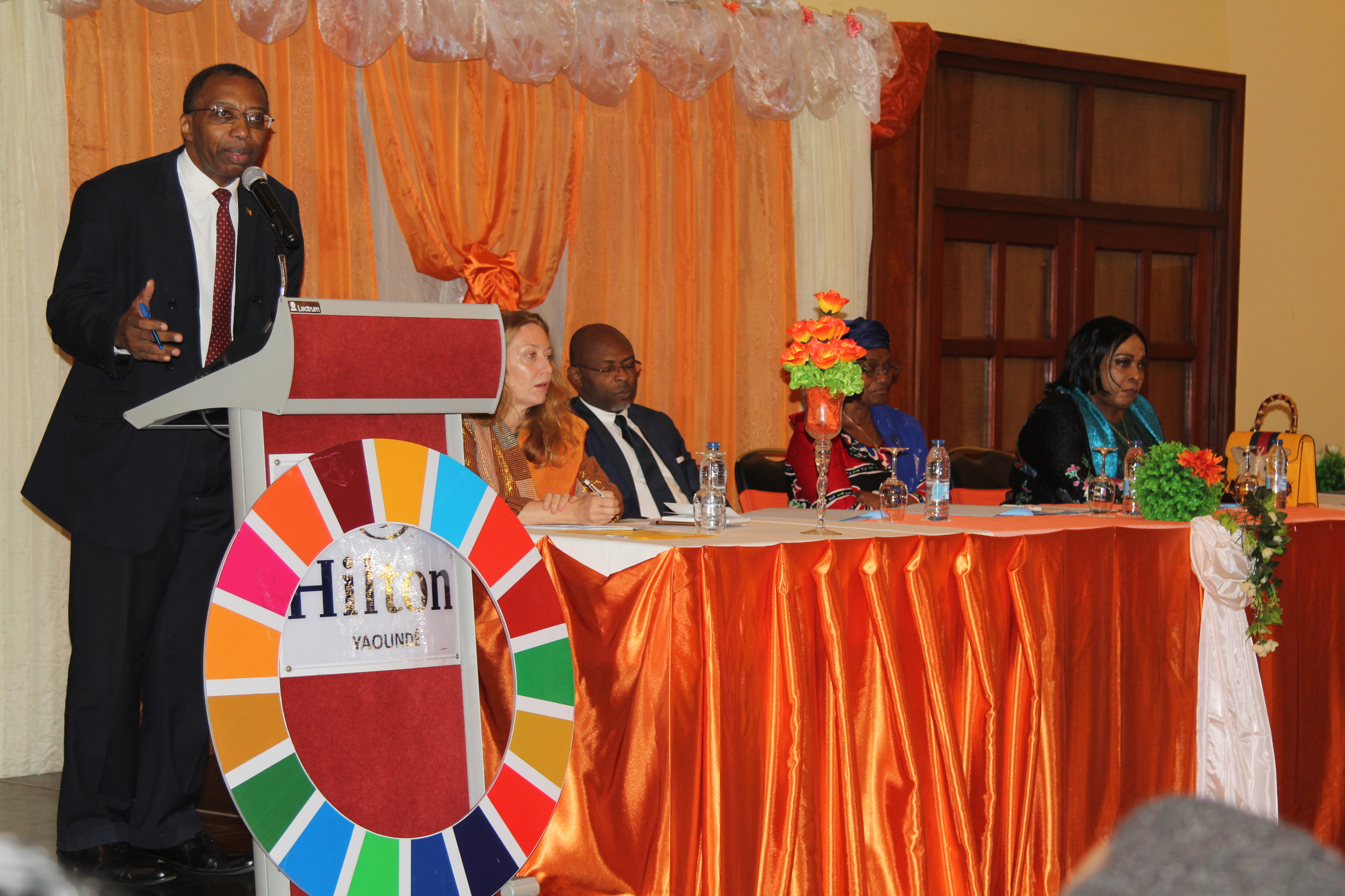 Professor Jean-Emmanuel Pondi, Vice Rector of the University of Yaoundé I, moderating the conference debate on sexual harassment in the university milieu during the ceremony to launch the 16 days of Activism campaign in Cameroon. Photo credit: Teclaire Same/UN Women