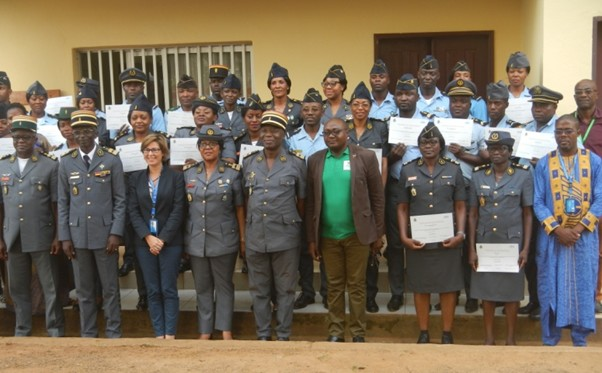 Newly trained gendarmerie officers proudly branding their attestations at the end of the 5 days training of trainers' seminar organized from 26 to 30 November 2018. Photo credit: Joseph Lindjeck, HeForShe volunteer.