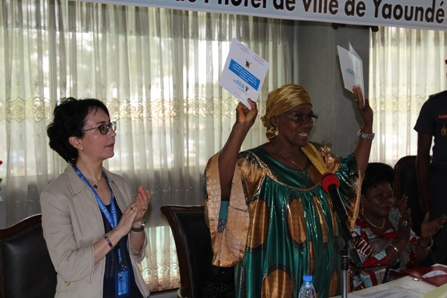 Minister Abena Ondoa Marie-Therese, MINPROFF, officially presenting the political education manual and national action plan to support women's participation in decision making. Photo credit: Teclaire Same, UN Women.