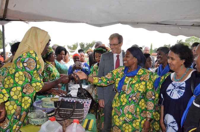 Minister Ummy Mwalimu, the UN Women Rep, Hodan Addou and the Swedish Ambassador, Anders Sjoberg share a lighter moment with some of the women manufacturing handbags displayed at one of the booths at an exhibition in Mwanza. UN Women/ Tsitsi Matope.