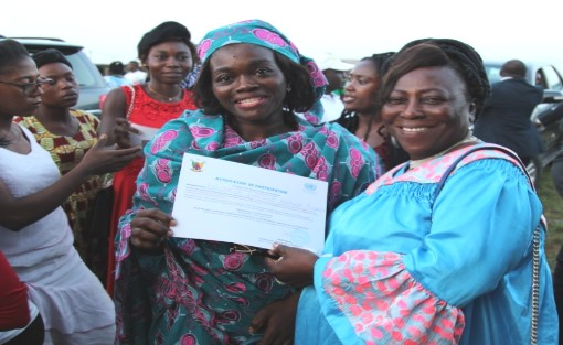 A participant receiving her attestation from the hands of  Honorable Lydienne Epoube. Photo credit: Emeline  Evina/HeForShe Volunteer/UN Women Cameroon