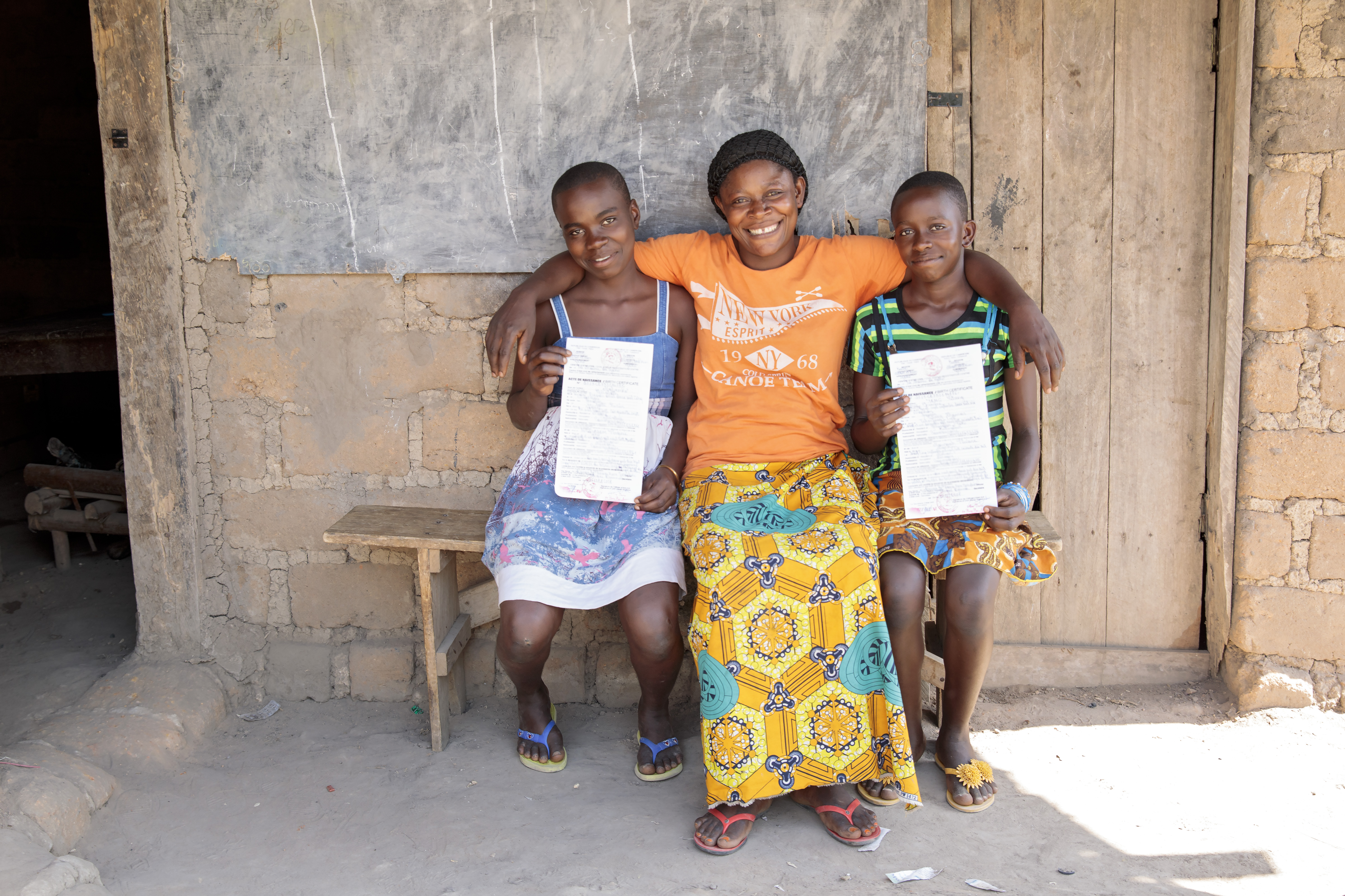Beneficiaries of Yoko proudly showing off their newly issued birth certificates