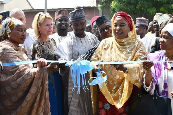 UN Women Deputy Executive Director Åsa Regnér, UN Women Nigeria Country Representative, Comfort Lamptey, Hon. Zuwaira Gambo Commissioner of Borno State Ministry of Women Affairs and Social Development and other key officials of the Borno State Government cutting the ribbon during the commissioning of a rice milling machine in Jere LGA of Borno State.
