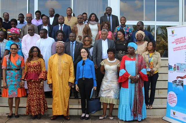 M. Eric Essousse, Director of ELECAM & Ms Hind Jalal, UN Women Deputy Rep (centre) posing for a group photo with media professionals.