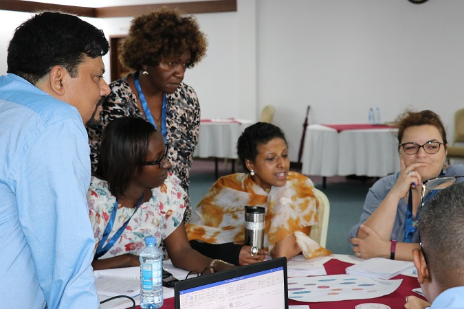 Participants engage in a group activity during a session on Gender Parity. Photo: UN Women/ Faith Bwibo