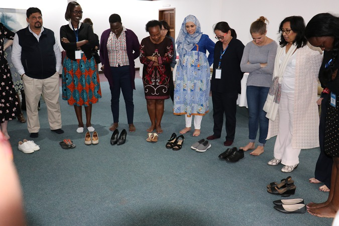 Purna Sen from UN Women (second from right)  leads participants in a group activity. Photo: UN Women/ Faith Bwibo