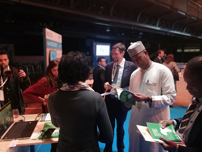 Tijjani Muhammad-Bande: President of the United Nations  General Assembly at the AGCCI booth © UN Women
