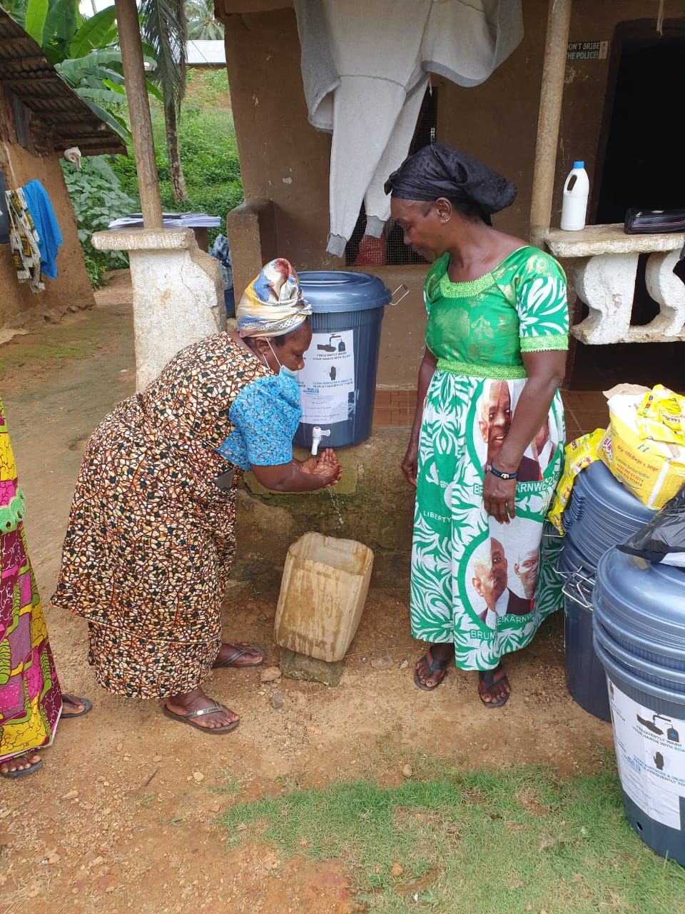Mrs. Kebeh Monger, National President of the Rural Women Structure of Liberia demonstrates how to wash hands to prevent the spread of COVID-19.
