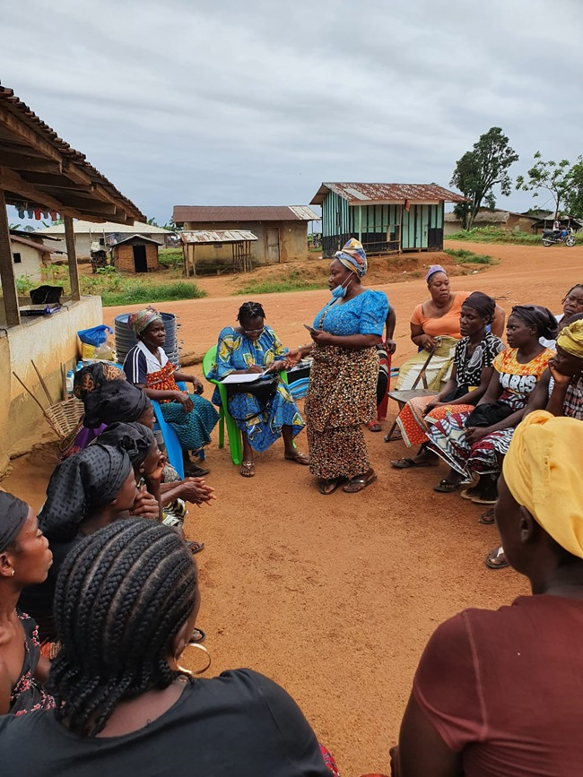 Mrs. Kebeh Monger, National President of the Rural Women Structure of Liberia addresses women during a COVID-19 awareness campaign