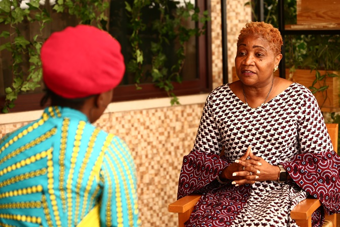 Veteran women's rights activist, Commissioner Tonieh Talery Wiles, talks to Vickjune Wutoh about women's rights and political leadership in Liberia. Photo: UN Women, Liberia